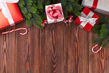 Christmas gift boxes and fir tree branch