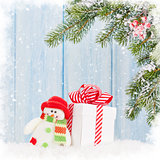 Christmas gift box, snowman toy and fir tree branch