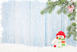 Christmas snowman toy and fir tree