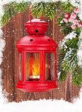 Christmas candle lantern on fir tree branch