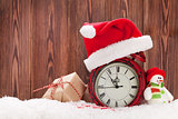 Christmas gift box, snowman and alarm clock