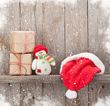 Christmas gift boxes, santa hat and snowman toy