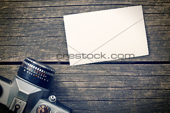 blank photo paper and retro camera