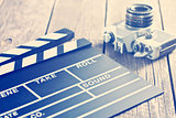 movie clapper and old camera