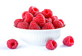 Big Pile of Fresh Raspberries in the White Bowl Isolated on White Background