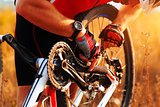 cyclist repairs bicycle on the meadow