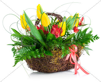 Bouquet yellow tulips basket green leaves