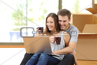 Couple buying online and moving house