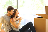 Couple hugging moving new house