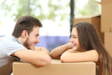 Couple moving house looking each other
