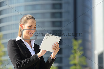 Business woman using a tablet in the street