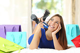 Girl holding a credit card thinking what to buy at home