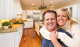 Happy Couple Inside Beautiful Custom Kitchen