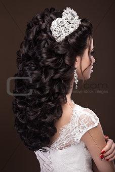 Beautiful brunette girl in image of Arab bride, wedding dress and crown on her head. Beauty face.