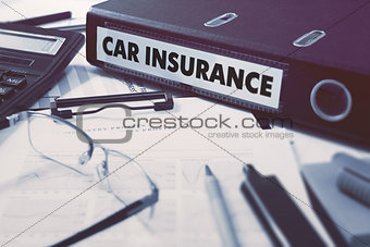 Car Insurance on Office Folder. Toned Image.