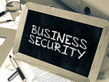 Business Security Handwritten by White Chalk on a Blackboard.