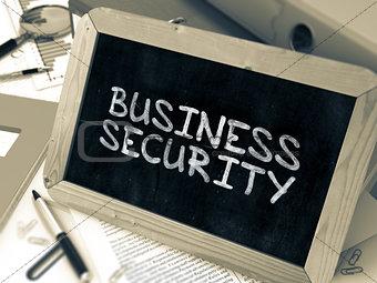 Business Security Handwritten by White Chalk on a Blackboard.