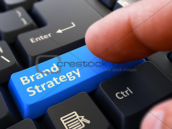 Brand Strategy Concept. Person Click Keyboard Button.