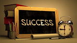 Success Handwritten on Chalkboard.