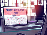 Small Business CRM - Concept on Laptop Screen.