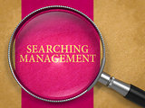 Searching Management through Lens on Old Paper.