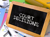 Handwritten Court Decisions on a Chalkboard.