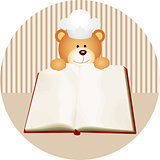 Teddy bear with blank cookbook