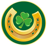 Golden Horseshoe and clover leaf. Symbol of good luck