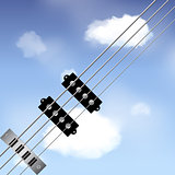 Bass guitar strings over sky