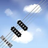 Bass guitar strings over sky