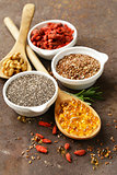 Super food - goji berries, chia seeds, flax seeds, walnuts and omega-3 capsules