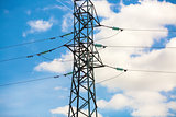 Electricity pylon against blue sky