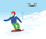 Snowboarding and remote drone with camera