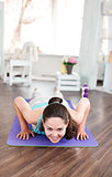 Young beautiful girl practicing fitness at home.
