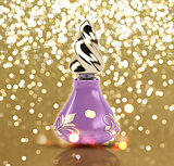 Glittery gold background with 3D perfume bottle