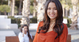 Smiling confident attractive young woman
