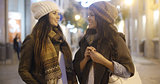 Two women chatting at a street in winter