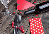 Romantic dinner set on wooden background
