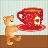Teddy bear carrying cup of tea