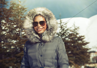 Beautiful woman in the winter mountains