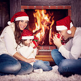 Happy family near fireplace