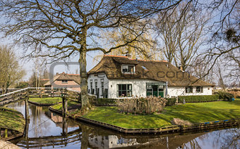 Old white farm in historical village Giethoorn