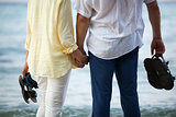 Couple holding hands at the seaside