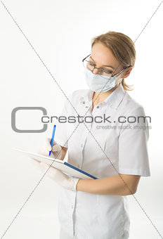 beautiful young female doctor in medical gown and rubber gloves holding a medical records. nurse making entries in medical records