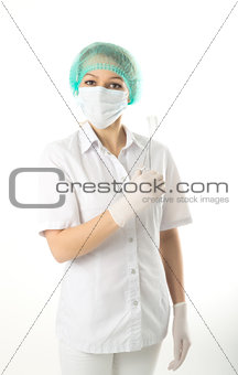 beautiful young female doctor in medical gown and rubber gloves holding a medical clamp. nurse