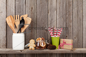 Kitchen utensils and christmas spices on shelf