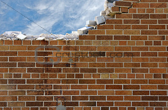 crumbling brick wall with sky