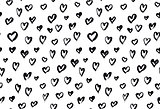 Seamless background pattern with hand drawn textured hearts