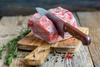 Cutting pork loin.