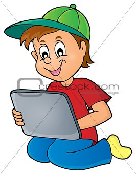 Boy playing with tablet